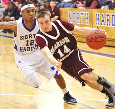 """<div class=""""source"""">Jessica Veatch</div><div class=""""image-desc"""">Sophomore Chase Lancaster drives around a North Hardin defender Friday night on the road.</div><div class=""""buy-pic""""><a href=""""http://web2.lcni5.com/cgi-bin/c2newbuyphoto.cgi?pub=015&orig=002_1.JPG"""" target=""""_new"""">Buy this photo</a></div>"""