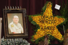 "<div class=""source"">Stevie Lowery</div><div class=""image-desc"">Marion County Deputy Sheriff Carl Anthony Rakes was killed Nov. 14, 2012, on Danville Highway after stopping to check on a vehicle.</div><div class=""buy-pic""><a href=""/photo_select/25034"">Buy this photo</a></div>"