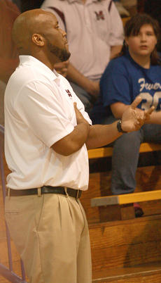 """<div class=""""source"""">Will Phillips</div><div class=""""image-desc"""">Lady Knights Coach Anthony Epps offers some gentle encouragement to his team.</div><div class=""""buy-pic""""><a href=""""http://web2.lcni5.com/cgi-bin/c2newbuyphoto.cgi?pub=015&orig=01-15_girls_bball_pic_7.jpg"""" target=""""_new"""">Buy this photo</a></div>"""