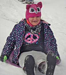 """<div class=""""source""""></div><div class=""""image-desc"""">Marisha Mitchellenjoys sledding in the snow in Gravel Switch on Saturday. Photo submitted by Lisha Mitchell.</div><div class=""""buy-pic""""></div>"""