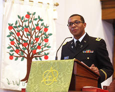 """<div class=""""source"""">Stevie Lowery</div><div class=""""image-desc"""">Christopher Rhodes, the associate pastor at St. Augustine Catholic Church, was the featured speaker at an event hosted by the local NAACP chapter Sunday afternoon. Rhodes is the first and only African American to be ordained into the priesthood within the Archdiocese of Louisville in more than 20 years. Rhodes is also the first and only African American Catholic clergyman to serve as chaplain for the Kentucky Army National Guard.</div><div class=""""buy-pic""""><a href=""""/photo_select/25097"""">Buy this photo</a></div>"""