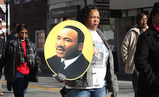 """<div class=""""source"""">Stevie Lowery</div><div class=""""image-desc"""">Geneva Bell holds a photo of Dr. Martin Luther King Jr., during a march led by the United Concerned Citizens Organization in downtown Lebanon Sunday.</div><div class=""""buy-pic""""><a href=""""/photo_select/25102"""">Buy this photo</a></div>"""