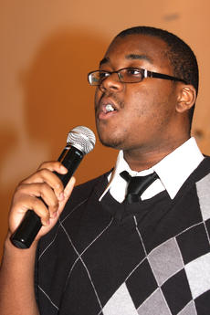 """<div class=""""source"""">Stevie Lowery</div><div class=""""image-desc"""">Malik Dorsey sings with the Bardstown group """"Young Men United."""" They performed during the MLK Jr. Day celebration Sunday at Lebanon United Methodist Church.</div><div class=""""buy-pic""""><a href=""""/photo_select/25106"""">Buy this photo</a></div>"""