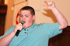 """<div class=""""source""""></div><div class=""""image-desc"""">Matthew Simmons sings with the Bardstown group """"Young Men United."""" They performed during the MLK Jr. Day celebration Sunday at Lebanon United Methodist Church.</div><div class=""""buy-pic""""><a href=""""/photo_select/25107"""">Buy this photo</a></div>"""