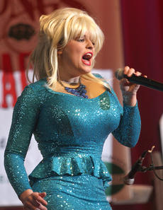 """<div class=""""source"""">Stephen Lega</div><div class=""""image-desc"""">Allie Hash shows off her enormous singing talent while impersonating Dolly Parton during Saturday evening's dinner show. </div><div class=""""buy-pic""""><a href=""""http://web2.lcni5.com/cgi-bin/c2newbuyphoto.cgi?pub=015&orig=01-29-14_kbmk-dinner_1.jpg"""" target=""""_new"""">Buy this photo</a></div>"""