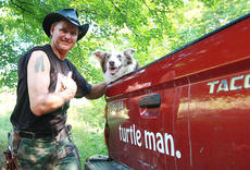 "<div class=""source"">Stephen Lega</div><div class=""image-desc"">Ernie Brown, Jr., a.k.a. The Turtleman, is the star on ""Animal Planet's Call of the Wildman"" TV show.</div><div class=""buy-pic""><a href=""http://web2.lcni5.com/cgi-bin/c2newbuyphoto.cgi?pub=015&orig=01-29-14_turtleman_mother_jones.jpg"" target=""_new"">Buy this photo</a></div>"