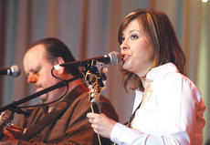 """<div class=""""source"""">Stephen Lega</div><div class=""""image-desc"""">Kelly Caldwell returned to the Kentucky Bluegrass Music Kickoff this year with her new band, The Mountain Connection.</div><div class=""""buy-pic""""><a href=""""/photo_select/9705"""">Buy this photo</a></div>"""