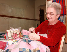"<div class=""source"">Stephen Lega</div><div class=""image-desc"">Dixie Hibbs makes repairs to a quilt from the 1890s during the Heart of Kentucky Quilt Show on Feb. 1. </div><div class=""buy-pic""><a href=""http://web2.lcni5.com/cgi-bin/c2newbuyphoto.cgi?pub=015&orig=02-05-14_quilt_show_pic_2.jpg"" target=""_new"">Buy this photo</a></div>"