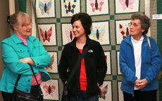 "<div class=""source"">Stephen Lega</div><div class=""image-desc"">From left, Betty White, Ann Mattingly and Wendy Dye chat in front of ""Butterfly Quilt"" by Leona Lee. </div><div class=""buy-pic""><a href=""http://web2.lcni5.com/cgi-bin/c2newbuyphoto.cgi?pub=015&orig=02-05-14_quilt_show_pic_4.jpg"" target=""_new"">Buy this photo</a></div>"