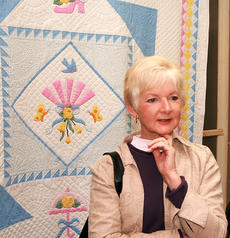"<div class=""source"">Stephen Lega</div><div class=""image-desc"">Gloria Parker looks at the quilts on display at the Heart of Kentucky Quilt Show. She is standing in front of ""My Fantasy: by Geneva Yarberry. </div><div class=""buy-pic""><a href=""http://web2.lcni5.com/cgi-bin/c2newbuyphoto.cgi?pub=015&orig=02-05-14_quilt_show_pic_5.jpg"" target=""_new"">Buy this photo</a></div>"