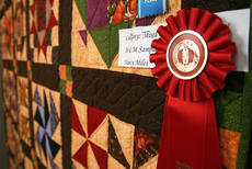 "<div class=""source"">Stephen Lega</div><div class=""image-desc"">""M&M Sampler"" by Nancy Miles was awarded second place overall in this year's Heart of Kentucky Quilt Show. </div><div class=""buy-pic""><a href=""http://web2.lcni5.com/cgi-bin/c2newbuyphoto.cgi?pub=015&orig=02-05-14_quilt_show_pic_6.jpg"" target=""_new"">Buy this photo</a></div>"