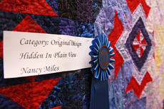 "<div class=""source"">Stephen Lega</div><div class=""image-desc"">The grand champion quilt in this year's Heart of Kentucky Quilt Show is ""Hidden in Plain View"" by Nancy Miles. </div><div class=""buy-pic""><a href=""http://web2.lcni5.com/cgi-bin/c2newbuyphoto.cgi?pub=015&orig=02-05-14_quilt_show_pic_7.jpg"" target=""_new"">Buy this photo</a></div>"