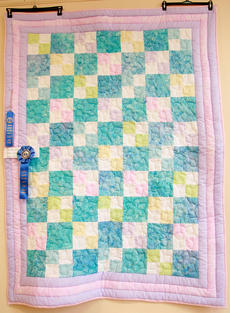 "<div class=""source"">Stephen Lega</div><div class=""image-desc"">""Amber's Glory"" by Amber Edlin took first place in the junior division at the Heart of Kentucky Quilt Show. </div><div class=""buy-pic""><a href=""http://web2.lcni5.com/cgi-bin/c2newbuyphoto.cgi?pub=015&orig=02-05-14_quilt_show_pic_8.jpg"" target=""_new"">Buy this photo</a></div>"