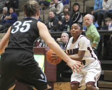 """<div class=""""source"""">Nick Schrager</div><div class=""""image-desc"""">Marion County Lady Knights freshman forward TeTe Adams looks for an opening against Mercy Academy Jaguar junior guard Malerie Martin. </div><div class=""""buy-pic""""><a href=""""/photo_select/32703"""">Buy this photo</a></div>"""