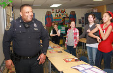 """<div class=""""source"""">Stevie Lowery</div><div class=""""image-desc"""">Officer Henry Keene, the DARE officer for the Lebanon Police Department, prepares to teach at class at Glasscock Elementary the Banana Dance.</div><div class=""""buy-pic""""><a href=""""http://web2.lcni5.com/cgi-bin/c2newbuyphoto.cgi?pub=015&orig=02-27-13%2Bblack%2Bhistory-keene%2Bpic%2B2.jpg"""" target=""""_new"""">Buy this photo</a></div>"""