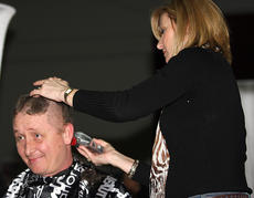 """<div class=""""source"""">Stevie Lowery</div><div class=""""image-desc"""">As a result of students' fund raising, teacher John Buckman agreed to shave his head during the fashion show.</div><div class=""""buy-pic""""><a href=""""/photo_select/18270"""">Buy this photo</a></div>"""