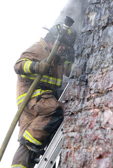 """<div class=""""source"""">Stephen Lega</div><div class=""""image-desc"""">Firefighter Jeremy Ballard climbs a ladder to try to get at the fire from a different angle. </div><div class=""""buy-pic""""><a href=""""/photo_select/32890"""">Buy this photo</a></div>"""