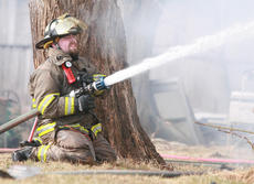 """<div class=""""source"""">Stephen Lega</div><div class=""""image-desc"""">Firefighter Kyle Varney keeps a hose aimed at house to prevent the fire from spreading.</div><div class=""""buy-pic""""><a href=""""/photo_select/32891"""">Buy this photo</a></div>"""