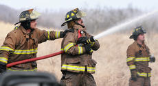 """<div class=""""source"""">Stephen Lega</div><div class=""""image-desc"""">Travis Garrett provides support for John Skaggs as he aims a hose at the house. Jeremy Ballard watches in the background.</div><div class=""""buy-pic""""><a href=""""/photo_select/32892"""">Buy this photo</a></div>"""