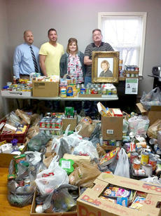 "<div class=""source"">Photo submitted</div><div class=""image-desc"">The Hair Zone hosted a food drive in honor of the late Marion County Clerk Karen Spalding. During the Feb 19 drive, they collected more than 2,000 cans of food and more than $700 to donate to the Community Service Center. Spalding's children Scott and Patrick Spalding, Shawna Richerson and her husband David ""Doc"" Spalding is pictured with the donated goods. Ilene Hughes of the Hair Zone said they intend to make this an annual event.  </div><div class=""buy-pic""></div>"