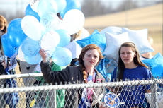 "<div class=""source"">Nick Schrager</div><div class=""image-desc"">Kaitlyn Spalding and Rachel Gootee watch as their classmates read memories of Tanner Strong.  </div><div class=""buy-pic""><a href=""/photo_select/32919"">Buy this photo</a></div>"