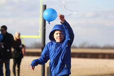 "<div class=""source"">Nick Schrager</div><div class=""image-desc"">Jackson Cash Strong, one of Tanner Strong's two brothers, prepares to release his blue balloon at the memorial service. </div><div class=""buy-pic""><a href=""/photo_select/32921"">Buy this photo</a></div>"