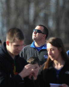 "<div class=""source"">Nick Schrager</div><div class=""image-desc"">Tanner's father, Joe Strong, looks skyward as students read memories of his son.  </div><div class=""buy-pic""><a href=""/photo_select/32925"">Buy this photo</a></div>"