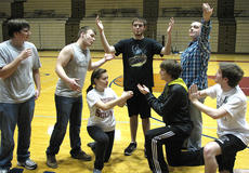 "<div class=""source"">Photo submitted</div><div class=""image-desc"">Pictured are Craig Deacon, Trevor Fitzpatrick, Trent Fenwick, Anthony Ballard, Anthony Chesser and Tanner Newton working on a pose for the self-expression routine with choreographer Mary Helen Hamilton. </div><div class=""buy-pic""></div>"