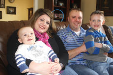 """<div class=""""source"""">Stevie Lowery</div><div class=""""image-desc"""">Pictured, from left, are 8-month-old Landon Thompson, his mother Stephanie, his father Pat and his 5-year-old brother Benjamin.</div><div class=""""buy-pic""""><a href=""""http://web2.lcni5.com/cgi-bin/c2newbuyphoto.cgi?pub=015&orig=03-09-11%2Bst%2Bbaldricks%2Bambassador%2B1.jpg"""" target=""""_new"""">Buy this photo</a></div>"""