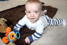 """<div class=""""source"""">Stevie Lowery</div><div class=""""image-desc"""">Landon Thompson is not a bit camera shy as he plays on the floor at his home Friday afternoon. Landon was diagnosed with bilateral retinoblastoma in January, and he is currently undergoing chemotherapy.</div><div class=""""buy-pic""""><a href=""""http://web2.lcni5.com/cgi-bin/c2newbuyphoto.cgi?pub=015&orig=03-09-11%2Bst%2Bbaldricks%2Bambassador%2B2.jpg"""" target=""""_new"""">Buy this photo</a></div>"""