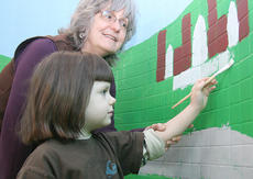 """<div class=""""source"""">Stephen Lega</div><div class=""""image-desc"""">Artist Pat Ritter helps kindergartener Abby Anzelmo as she works on a mural at Lebanon Elementary.</div><div class=""""buy-pic""""><a href=""""/photo_select/10611"""">Buy this photo</a></div>"""