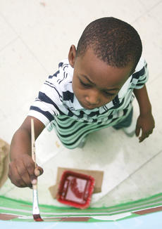 """<div class=""""source"""">Stephen Lega</div><div class=""""image-desc"""">Kindergartner C.J. Neal keeps focused on painting his section of the mural.</div><div class=""""buy-pic""""><a href=""""/photo_select/10614"""">Buy this photo</a></div>"""