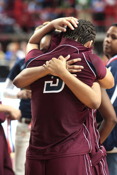 "<div class=""source"">Jessica Veatch</div><div class=""image-desc"">Makayla Epps hugs a teammate after the Lady Knights' loss to Manual Saturday.</div><div class=""buy-pic""><a href=""/photo_select/10643"">Buy this photo</a></div>"