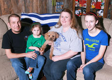 """<div class=""""source"""">Stephen Lega</div><div class=""""image-desc"""">Darrel Ballard is pictured with his wife, Stacy, their daughters, Bethany (14) and Autumn (4) and their dog, Charlie.</div><div class=""""buy-pic""""><a href=""""http://web2.lcni5.com/cgi-bin/c2newbuyphoto.cgi?pub=015&orig=03-19-14_heart_transplant_pic_2.jpg"""" target=""""_new"""">Buy this photo</a></div>"""