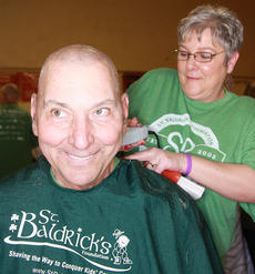 "<div class=""source"">Stephen Lega</div><div class=""image-desc"">Bob Mattingly is all smiles while stylist Connie Smith shaves his head.</div><div class=""buy-pic""><a href=""/photo_select/33115"">Buy this photo</a></div>"