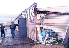 "<div class=""source"">Stephen Lega</div><div class=""image-desc"">Extension Agent Rebecca Hill and Steve Downs, president of the Marion County extension board, examined the damage where lightning struck the rear of the office Monday morning.</div><div class=""buy-pic""><a href=""/photo_select/26206"">Buy this photo</a></div>"