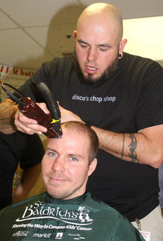 """<div class=""""source"""">Stevie Lowery</div><div class=""""image-desc"""">Matthew Rogers of Disco's in Campbellsville carefully guides the clippers across Chris Hamm's head. </div><div class=""""buy-pic""""><a href=""""/photo_select/33512"""">Buy this photo</a></div>"""