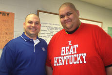 """<div class=""""source"""">Stevie Lowery</div><div class=""""image-desc"""">Brandon Wilson, SAP director, and Scott Patten show who they were rooting for Friday before the UK and U of L game. </div><div class=""""buy-pic""""><a href=""""/photo_select/33513"""">Buy this photo</a></div>"""