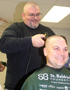 """<div class=""""source"""">Stevie Lowery</div><div class=""""image-desc"""">SAP director Brandon Wilson was the first shavee Friday at the St. Baldrick's event at the Marion County Detention Center.  Daniel Bishop of Disco's in Campbellsville had the honor of shaving Wilson's head. </div><div class=""""buy-pic""""><a href=""""/photo_select/33503"""">Buy this photo</a></div>"""