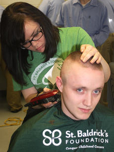 """<div class=""""source"""">Stevie Lowery</div><div class=""""image-desc"""">Taylor Claypool of Kim's Hairlines shaves Bobby Wilson's head. </div><div class=""""buy-pic""""><a href=""""/photo_select/33504"""">Buy this photo</a></div>"""