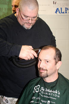 """<div class=""""source"""">Stevie Lowery</div><div class=""""image-desc"""">Royal Setters looks cool as a cucumber as Daniel Bishop of Disco's in Campbellsville shaves his head. </div><div class=""""buy-pic""""><a href=""""/photo_select/33506"""">Buy this photo</a></div>"""