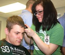 """<div class=""""source"""">Stevie Lowery</div><div class=""""image-desc"""">Taylor Claypool of Kim's Hairlines shaves Gary Rowland's head. </div><div class=""""buy-pic""""><a href=""""/photo_select/33507"""">Buy this photo</a></div>"""