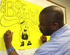 """<div class=""""source"""">Stevie Lowery</div><div class=""""image-desc"""">Carlos Shelton signs the St. Baldrick's poster after having his head shaved. </div><div class=""""buy-pic""""><a href=""""/photo_select/33508"""">Buy this photo</a></div>"""