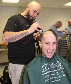 """<div class=""""source"""">Stevie Lowery</div><div class=""""image-desc"""">Joshua Newby laughs as Matthew Rogers of Disco's in Campbellsville takes the clippers to his head. </div><div class=""""buy-pic""""><a href=""""/photo_select/33509"""">Buy this photo</a></div>"""