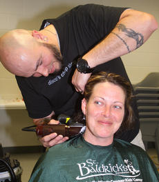 """<div class=""""source"""">Stevie Lowery</div><div class=""""image-desc"""">Melissa Hoisington, assistant director of the SAP program, got in on the action, too, by having a portion of her head shaved. Pictured with Hoisington is Matthew Rogers of Disco's in Campbellsville. </div><div class=""""buy-pic""""><a href=""""/photo_select/33510"""">Buy this photo</a></div>"""