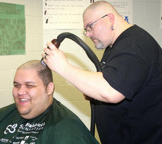 """<div class=""""source"""">Stevie Lowery</div><div class=""""image-desc"""">Scott Patten smiles as Daniel Bishop of Disco's in Campbellsville shaves his head. </div><div class=""""buy-pic""""><a href=""""/photo_select/33511"""">Buy this photo</a></div>"""