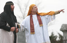 "<div class=""source"">Stephen Lega</div><div class=""image-desc"">Religious leaders (Mark Cassidy, left, and Mike Holt) point out the temple veil, which tore at the moment of Jesus's death, according to the Gospel. </div><div class=""buy-pic""><a href=""/photo_select/26486"">Buy this photo</a></div>"