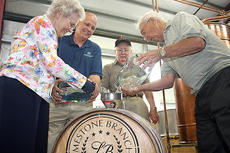"""<div class=""""source"""">Stevie Lowery</div><div class=""""image-desc"""">Pictured, from left, are Steve Beam's mother, Dorothy Ann Browning, his father, James P. Beam Sr., and his uncle Jack Beam filling Limestone's first bourbon barrel.</div><div class=""""buy-pic""""><a href=""""http://web2.lcni5.com/cgi-bin/c2newbuyphoto.cgi?pub=015&orig=04-18-12%2Blimestone%2Bfirst%2Bbarrell%2B2.jpg"""" target=""""_new"""">Buy this photo</a></div>"""
