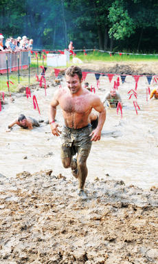 "<div class=""source"">Photos provided by Red Frog Events, LLC</div><div class=""image-desc"">During the race, Warrior Dash participants much crawl through mud pit, while avoiding the barb wire.</div><div class=""buy-pic""></div>"
