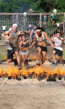 "<div class=""source"">Photos provided by Red Frog Events, LLC</div><div class=""image-desc"">At the conclusion of the race, runners must leap over rows of fire in the final obstacle, the Warrior Roast.</div><div class=""buy-pic""></div>"